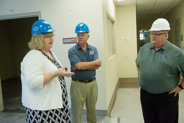 Globe/Roger Nomer<br /> (from left) Kathy Parker-Collier, grants director at Crowder College, Andy Wilson, AMT lead instructor, and Glenn Coltharp, vice president, talk at the Advanced Training and Technology Center on Wednesday.