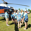 Campers at Camp Quality  get a close up look at a Mercy air ambulance on Tuesday at the camp near Neosho. The week-long camp, which is one of 15 in the U.S.,  offers children ages 4 to 18 battling cancer a chance to be  kids again.<br /> Globe | Laurie Sisk