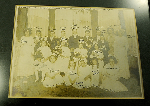 A 1913 photograph of the first confirmation class for the United Hebrew Congregation, taken before the temple was constructed,  sits inside the United Hebrew Congregation Temple at 702 S. Sergeant St. The temple turned 100 years old this year.<br /> Globe | | Laurie Sisk