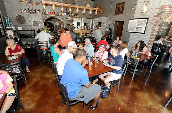A packed house enjoys lunch Thursday at the 10th Street Cave Gang Pizza and Pub in Carthage.<br /> Globe | Laurie Sisk