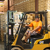 Globe/Roger Nomer<br /> James Lakey uses a forklift at Leisure Time Products on Thursday.