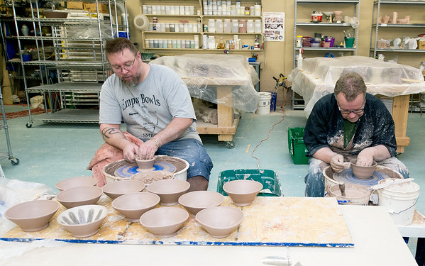 From the left: Geoffrey Kunkler and Mark Strayer throw bowls for the Empty Bowl A Thon on Saturday at Phoenix Fired Art. About 20 volunteers attended the two day event to make bowls for the annual fundraiser. Organizers early Saturday said the volunteers are more than halfway toward their goal of $1,200 bowls.<br /> Globe | Laurie Sisk