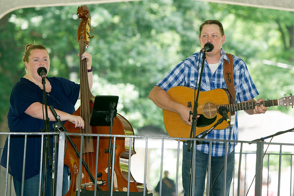 """Members of """"Borderline Bluegrass"""" perform for the crowd at the Carthage Bluegrass Festival on Saturday at Carthage's Central Park.<br /> Globe 
