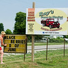 Ray's Farm to Market, LLC manager Tina Tate changes a sign on Hwy. 39 to alert motorists of the upcoming sale of blackberries at the farm on Saturday near Mount Vernon.<br /> Globe | Laurie Sisk