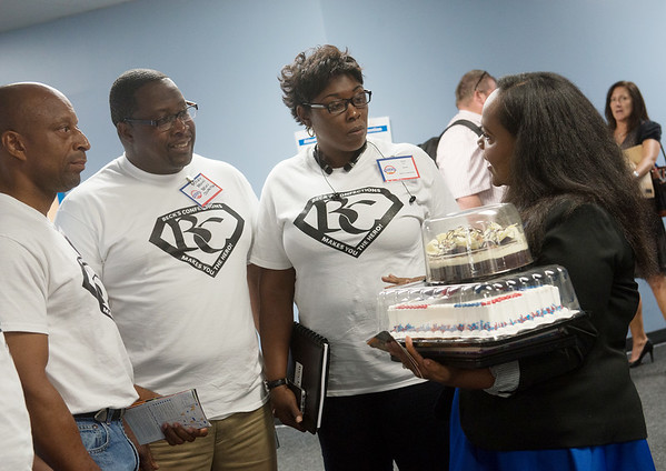 Globe/Roger Nomer<br /> (from left) Darius McBeath, Shelby Brown and Annie Beck, of Beck's Confections in Gulf Port, Miss., talk with Kinna Thomas, senior buyer for cakes and pies, on Tuesday at the open call at Walmart's Home Office in Bentonville.