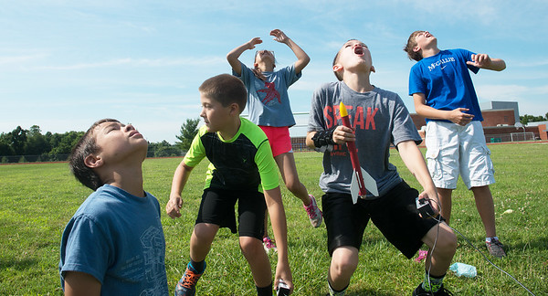 Globe/Roger Nomer<br /> Dixon Reid, sixth grade, second from left, races to retrieve his rocket as other students watch the launch on Wednesday at Thomas Jefferson Independent Day School's rocket camp.