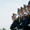 Globe/Roger Nomer<br /> Members of the Robert Thurman American Legion Post salute as the casket arrives at a veteran's funeral in Diamond on Tuesday.