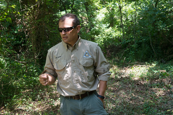 Globe/Roger Nomer<br /> Rick Horton talks about the cave spring fish near the entrance to a cave in Sarcoxie on Thursday.