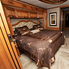 A full king size mattress graces the spacious bedroom of the Newmar Londonaire motorhome.<br /> Globe | Laurie Sisk