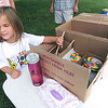 Five-year-old Lena Owens hands out lollipops for visitors at the 36th Annual Joplin PoPs on Friday at Missouri Southern. The event was produced by Pro Musica, a non-profit group that provides works to instill an appreciation of classical music in Joplin.<br /> Globe | Laurie Sisk
