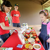 From the left: Joplin Health Department Community Health Planner/Educator Jillian Pollard and Director Dan Pekarek visit with Katie Becker, 10, as they share information on nutrition and area trails during National Trail Day on Saturday at George Washington Carver National Monument. Pollard and Pekarek were representing LiveSmart, a program through the Jasper and Newton Counties Community Health Collaborative.<br /> Globe | Laurie Sisk