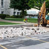 Globe/Roger Nomer<br /> Workers remove the sidewalk around the Jasper County Courthouse in Carthage on Wednesday.