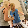 Globe/Roger Nomer<br /> Jennifer and Sydney, 10, Strickland, Oronogo, shop for sunglasses at Sunny Shades at the Northpark Mall on Thursday.