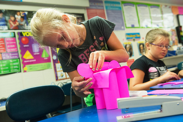 Globe/Roger Nomer<br /> Emma Cottrell, left, and Macie Pence, fifth graders, work on elephants at Galena on Wednesday.