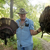Globe/Roger Nomer<br /> Don Shilling displays turkey feathers on Tuesday.