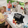 Participants check in before the start of the Missouri Prairie Foundation's Bio Blitz on Saturday at Linden's Prairie near Mount Vernon. About 100 people attended the event, which offered an up close look at the various species of flora and fauna in the prairie's ecosystem.<br /> Globe | Laurie Sisk