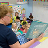 Globe/Roger Nomer<br /> Rebecca Spencer reads a book to her class at the Missouri Southern Early Childhood Development Center on Friday.
