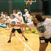 Globe/Roger Nomer<br /> Salena Perez, a Missouri Southern junior from Joplin, throws to her partner during Thursday's Lifetime Sports Academy at the Leggett and Platt Athletic Center.
