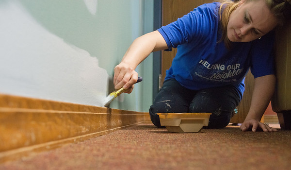 Globe/Roger Nomer<br /> Ashley DeGonia, with SMB, paints a wall at the Children's Center on Friday as part of the United Way's Day of Action.
