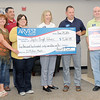 Representatives from Arvest Bank present more than $5,200 to the Joplin School District's Bright Futures Program during a ceremony on Friday at the bank's McClelland street location. From the left: Joplin RVII Bright Futures Chairwoman Christie Barnhart, Chad Evans, of Arvest, RVIII Director of Community Engagement Michelle Winston and Rebecca Dunham, Stuart Puckett and Mike Brown, all of Arvest.<br /> Globe | Laurie Sisk