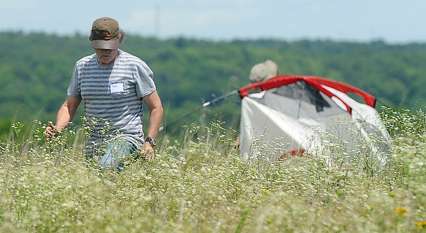 Participants set up their tents for a two-day exploration of Linden's Prairie near Mount Vernon. About 100 people attended the event, which was sponsored by the Missouri Prairie Foundation. The Bio Blitz offered an up close look at the various species of flora and fauna in the prairie's ecosystem.<br /> Globe | Laurie Sisk