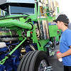 Chevy Bolle, 12, of Longview, Teaxas, checks out the engine on a 2015 389 Peterbilt Glider, owned by A.J. Lopez and driven by Johnny Villanueva during the Shell Rotella Superrigs event on Friday in downtown Joplin.<br /> Globe | Laurie Sisk