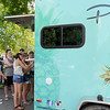 PAtrons line up in droves for Pineapple Bliss on Friday at the Friday Food Truck event in Carthage.<br /> Globe | Laurie Sisk