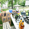 Theresa Block helps set up the beer garden, sponsored by Cherry's Art Gallery, on Friday at the Friday Food Truck event in Carthage.<br /> Globe | Laurie Sisk
