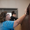 Globe/Roger Nomer<br /> Melissa Winston, left, and Melissa Doura, both with Joplin Public Schools, stain a wall at Crosslines on Friday as part of the United Way's Day of Action.