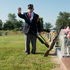 Globe/Roger Nomer<br /> John Newberry signals to the members of the Robert Thurman American Legion Post to get into position for a funeral at the Diamond Cemetery on Tuesday.