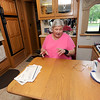 Full-time RVer Mary Anglin prepares to pay bills at the kitchen table inside her motorhome on Thursday at Coachlight.<br /> Globe | Laurie Sisk