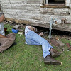 From the left: HistoriCorps volunteers Kim Mailes, Joplin and archaeologist Keith Blades, Joplin, inspect the foundation  of George Washington Carver's first schoolhouse on Young street in Neosho on Wednesday. Blades said foundations for buildings at that period were constructed of piled rocks instead of traditional concrete.<br /> Globe | Laurie Sisk