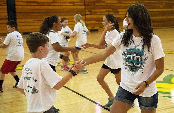 Globe/Roger Nomer<br /> Monica Clement, a Missouri Southern junior from Carl Junction, dances with Miles Pratt, 11, during Thursday's Lifetime Sports Academy at Missouri Southern. This is the 20th year for the summer camp, held by the MSSU Kinesiology Department. The academy helps children experience a wide range of sports that they can participate in throughout their lifetime.