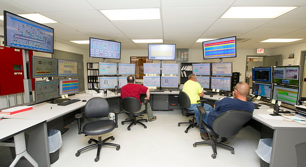 Empire District Electric employees monitor operating information inside the control room of Empire's new combined cycle power plant on Tuesday in Riverton.<br /> Globe | Laurie Sisk