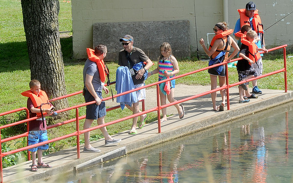 Kids enjoy a chance to fish in the pond at Camp Quality near Neosho on Thursday. The camp offers full slate of activities during the week-long event for kids battling cancer.<br /> Globe | Laurie Sisk