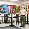 """Photo Courtesy of Crowder College<br /> Allen Bishop, a recently retired art instructor at Crowder College, talks about the mural titled """"Plan, Lean, Care, Create, Serve,"""" created by students in the Arnold Farber Building on Wednesday."""
