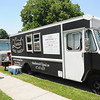 Customers line up at some of the food trucks on Friday at the Friday Food Truck event in Carthage. About a dozen trucks participated in the monthly event.<br /> Globe | Laurie Sisk