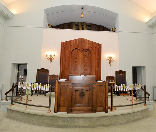A large wooden engraved enclosure, center, holds the The Five Books of Moses in the sanctuary of the United Hebrew Congregation Temple at 702 S. Sergeant St. The temple turned 100 years old this year.<br /> Globe | | Laurie Sisk