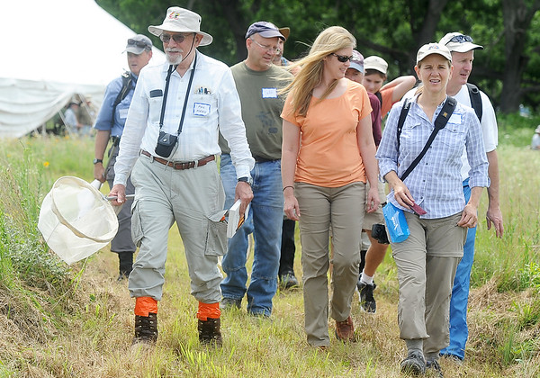 Lepidopterist Phil Koenig, left, leads a group of butterfly enthusiasts on a trek to record data on the various species of butterflies during a BioBlitz at Linden's Prairie near Mount Vernon on Saturday. The event was sponsored by the Missouri Prairie Foundation.<br /> Globe | Laurie Sisk