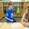 Globe/Roger Nomer<br /> Brandi Landis helps AJ Ferrell, second grade, with an exercise on Monday at Soaring Heights Elementary.