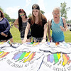 From the left: Ariana Atwood, 15, Cydney Deberry, 16, Alexandra Ginser, 17 and Teresa Ginser look through merchandise at the Joplin Pridefest on Saturday at Landreth Park. Organizers from Joplin Pride said they expected about 1,000 people to attend the day-long event for the area LGBT community and its allies.<br /> Globe | Laurie Sisk
