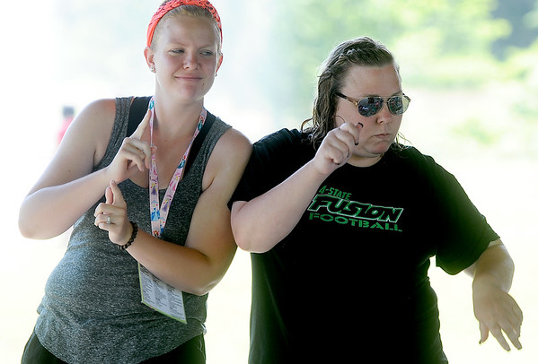 Camp Quality Co-Executive Director Kristin Patterson and volunteer companion Laura Dieckhoff join in on an impromptu dance party on Thursday at the camp for kids battling cancer.<br /> Globe | Laurie Sisk