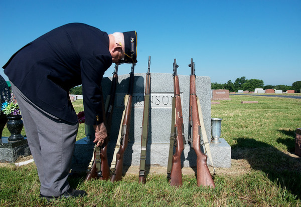 Globe/Roger Nomer<br /> John Newberry prepares guns for the Robert Thurman American Legion Post detail at a funeral at the Diamond Cemetery on Tuesday.