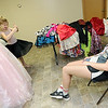 """Camper Leigha Y. delights in the dress she picked out in the """"Say Yes to the Dress Boutique"""" as her companion Keri Walter looks on Thursday at Camp Quality near Neosho. Girls get to chose from a wide variety of dresses for the annual dance - the last of a week full of activities for kids battling cancer.<br /> Globe 