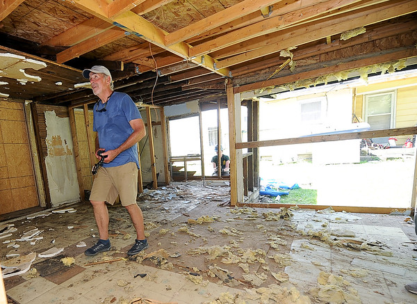 HistoriCorps volunteer Joe Daniel, of Boulder, Colo., assesses the condition of the interior of George Washington Carver's first schoolhouse on Young street in Neosho on Wednesday.<br /> Globe | Laurie Sisk