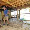 HistoriCorps volunteer Joe Daniel, of Boulder, Colo., assesses the condition of the interior of George Washington Carver's first schoolhouse on Young street in Neosho on Wednesday.<br /> Globe   Laurie Sisk