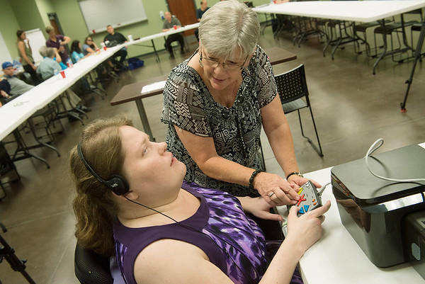 Globe/Roger Nomer<br /> Marilyn Baugh, Jasper County Clerk, helps Brittany Stovall, a disability advocate at the Independent Living Center, with voting equipment on Wednesday at the Center. The demonstration helped disabled voters become acquainted with the voting machines before the election.