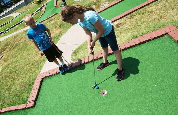 Globe/Roger Nomer<br /> Katie and Cooper Pennington, Nevada, play miniature golf at Rangeline Golf Center on Monday afternoon.