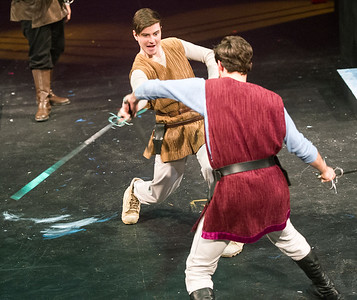 Servants from the Houses of Capulet and Montague engage in a sword fight during rehearsal for Romeo and Juliet on Wednesday night at Missouri Southern. From the left: James Keating as Sampson and Carlos Almedo as Abraham. Globe | Laurie Sisk