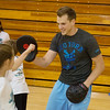 Globe/Roger Nomer<br /> Brady Melugin, a Missouri Southern senior from Jackson, Mich., helps children with karate skills during Thursday's Lifetime Sports Academy at Young Gymnasium.